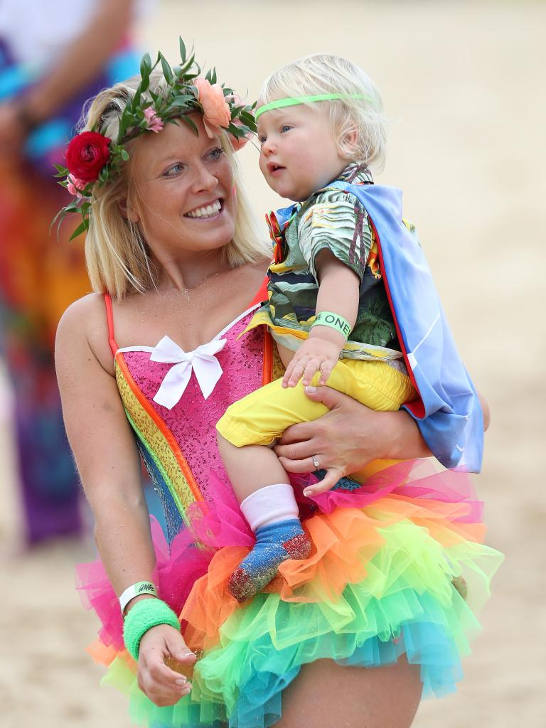 A woman and child dressed up to take part in 'Fluro Friday', which is part of OneWave, an awareness group for mental health and wellbeing.