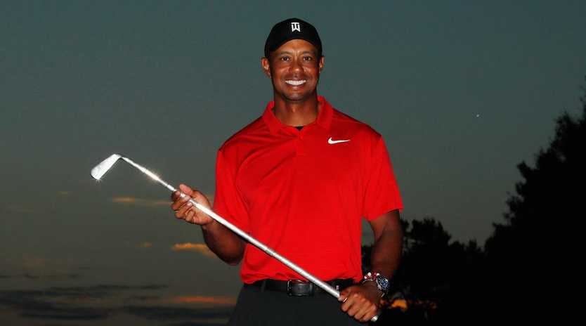 ATLANTA, GA - SEPTEMBER 23: Tiger Woods of the United States poses with the trophy after winning the TOUR Championship at East Lake Golf Club on September 23, 2018 in Atlanta, Georgia. (Photo by Kevin C. Cox/Getty Images)