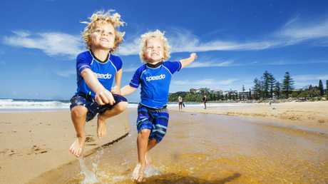 Brothers Henry Fyfe, 4, and Tommy, 3, make the most of the sunshine at Tooway Creek, Moffat Beach, as the wet weather finally clears … for a while. Picture: Lachie Millard