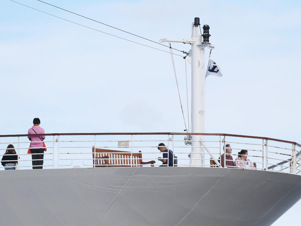 Passengers wait for news on the top deck of the Radiance of the Seas after the ship was flooded with police on Thursday morning. Picture: Nikki Davis-Jones