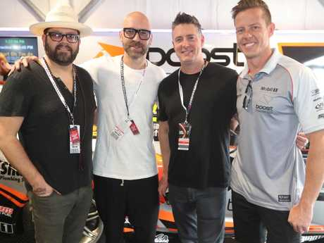 Live band members Chad Taylor, Ed Kowalczyk and Chad Gracey with driver James Courtney. Picture: Richard Gosling