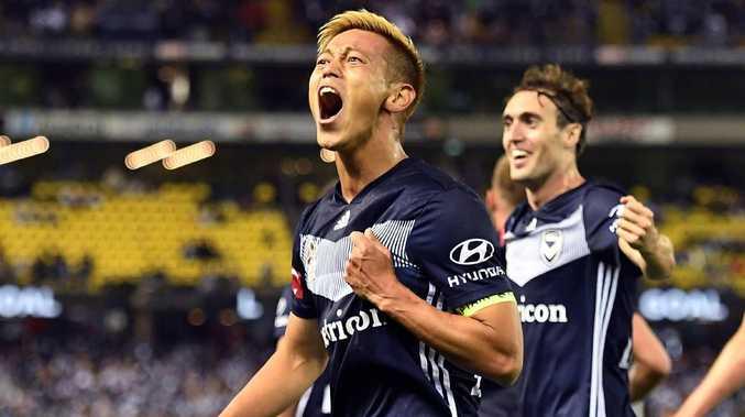 Keisuke Honda celebrates after scoring his goal. Picture: AFP Photo