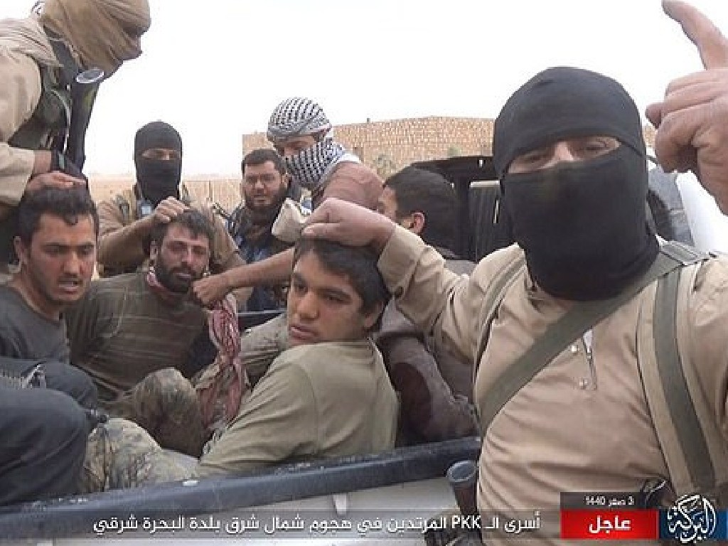Footage shows Islamic State terrorists taking hostages and displaying their characteristic one finger salute. Picture: Supplied