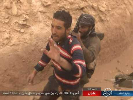Footage shows what is believed to be an ISIS Islamic member taking a displaced person hostage in Syria. Picture: Supplied