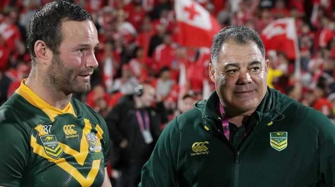 Captain Boyd Cordner and coach Mal Meninga after the Kangaroos defeated Tonga at Mt Smart Stadium. (AAP Image/David Rowland)