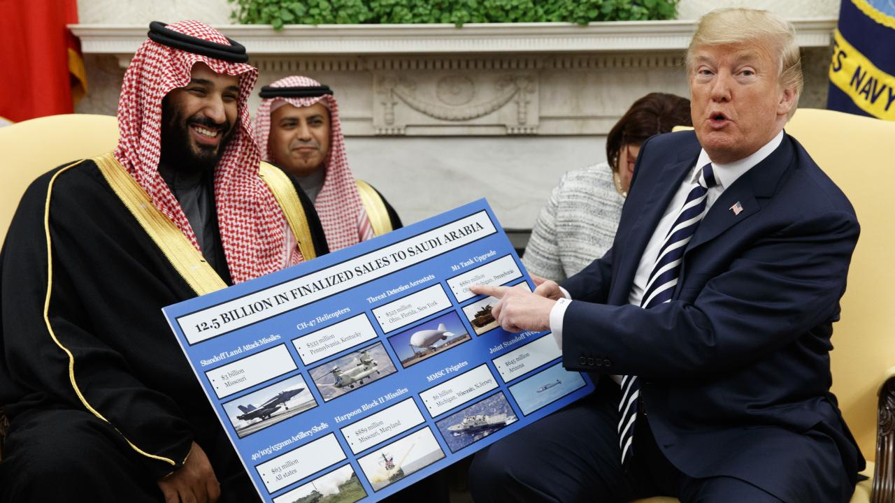 US President Donald Trump holds a chart highlighting arms sales to Saudi Arabia during a meeting with Saudi Crown Prince Mohammed bin Salman in the Oval Office of the White House in Washington, March 2018. Picture: Evan Vucci/AP