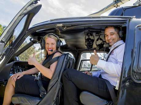 High flyers: Minister for Innovation and Tourism Industry Development Kate Jones takes a scenic flight over the race precinct with Supercars CEO Sean Seamer. Picture: Jerad Williams