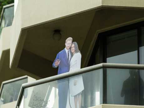 Neighbours of the ANZAC memorial welcomed the couple with a cardboard cutout.