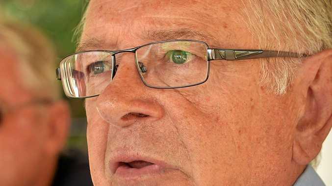 MP Ted O'Brien addresses Mudjimba Beach residents concerns with resident Martin Peelgrane.