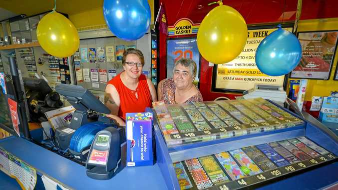 Lucky Winner: Nola Last and Kristie Masters work at a Gladstone news agency where a Division One ticket was sold.