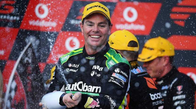 Craig Lowndes celebrates his bizarre win on the Gold Coast. Picture: Getty