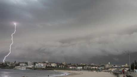 A lightning bolt strikes as a storm cell rolls over Bondi Beach on Saturday. Picture: AAP Image/Chris Pavlich
