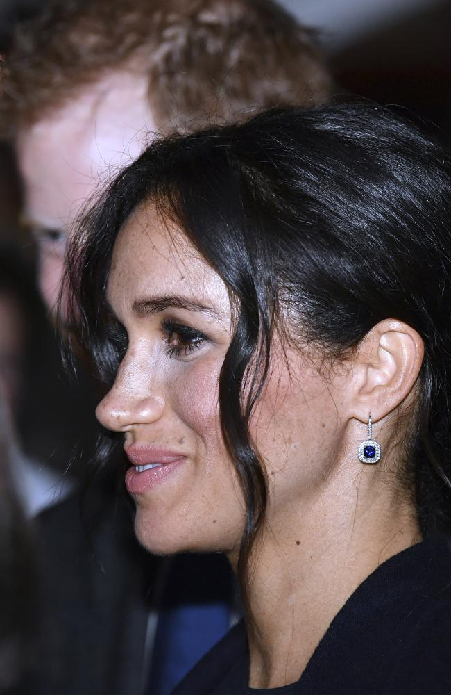 Meghan, Duchess of Sussex, with her husband Britain's Prince Harry meets guests at a reception inside Sydney's iconic Opera House Saturday, Oct. 20, 2018. (Saeed Khan/Pool Photo via AP)