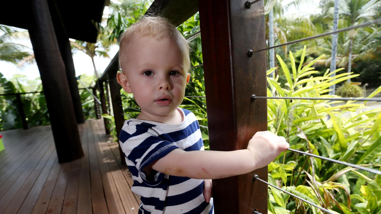 Naish Rutland, 22-months, was almost eaten by a python on his veranda. Picture: Stewart McLean.