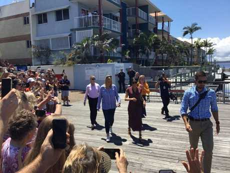 Meghan, Duchess of Sussex passes through crowds at the Hervey Bay Marina.