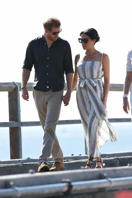 Prince Harry and Princess Meghan walk along Kingfisher Bay jetty on Fraser Island.