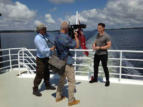 James Longman from ABC News (America) doing a piece to camera as we head to Fraser Island on the Fraser Dawn.