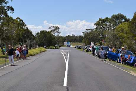 Hundreds have gathered and are lining the road leading to the Hervey Bay airport.