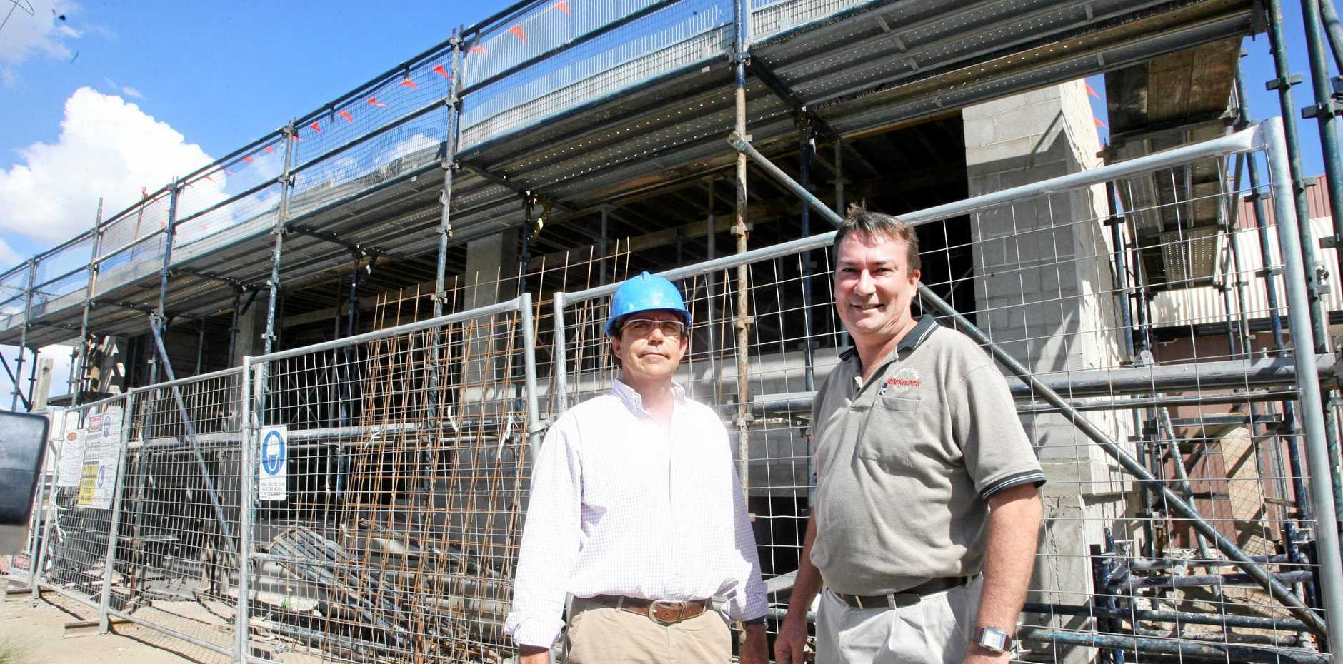 Owner/builder Peter Comino (left) and Paul Mills discuss the construction of the CBD Executive Apartments in 2008.