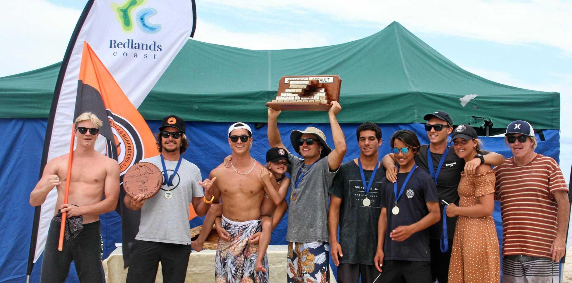 The Snapper Rocks Surfiders Club celebrate their 24th 'Straddie Teams Assault' win at North Stradbroke Island.