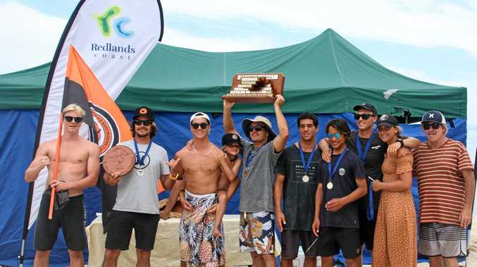 The Snapper Rocks Surfiders Club celebrate their 24th 'Straddie Teams Assault' win at North Stradbroke Island.