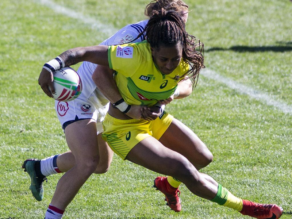 Ellia Green is tackled by USA's Alev Kelter during the women's sevens event in Colorado. Pic: AFP