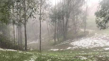 Hail carpets the ground at Samford Valley near Brisbane. Picture: Mark Sandford