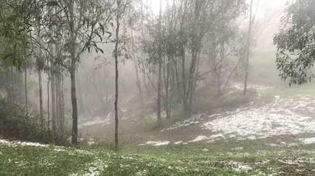 Hail carpets the ground at Samford Valley near Brisbane. Picture: Mark Sandford