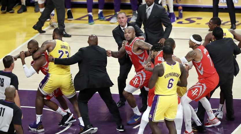 Chris Paul is restrained by LeBron James. (AP Photo/Marcio Jose Sanchez)