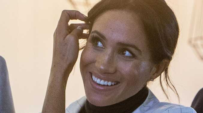 Meghan's white sneakers a hit