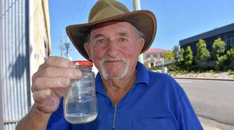CONCERNED RESIDENT: Gympie's Peter Murtagh with the non-biting midge discovered more than two weeks ago.
