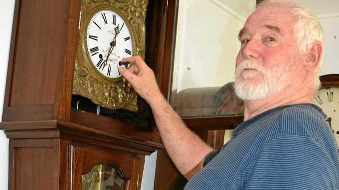 Horologist Kev Lamb has a clock shop at Grevillia.