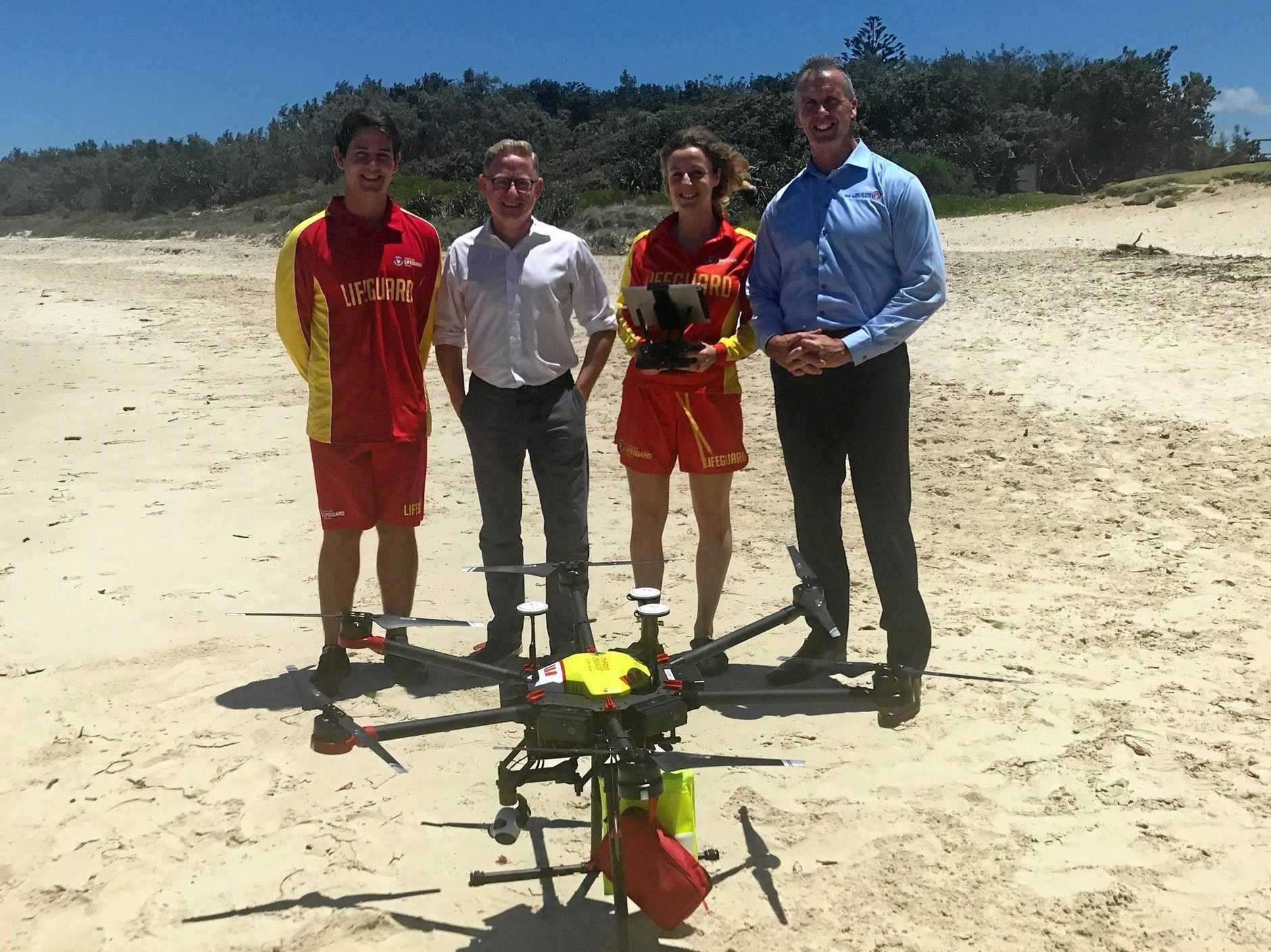 DRONE: Parliamentary Secretary for Northern NSW Ben Franklin with local lifesavers and CEO of Surf Life Saving NSW Stephen Pearce.