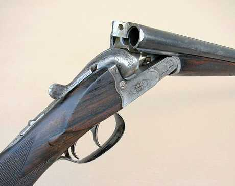 OLD GIFT: Example of a Simpson & Suhl double barrel shotgun.