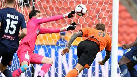 Brisbane Roar striker Adam Taggart has a header on goal saved by Central Coast Mariners goalkeeper Ben Kennedy on Sunday. Picture: Getty Images