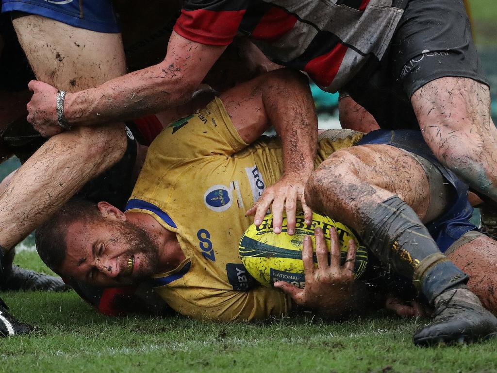 Quade Cooper at the bottom of a ruck during the battle for an NRL grand final berth against Vikings. Picture: Peter Wallis