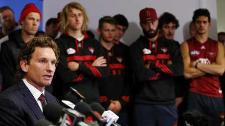 James Hird faces the media in front of the entire playing list, confirming his resignation as Essendon coach. Picture: Michael Klein
