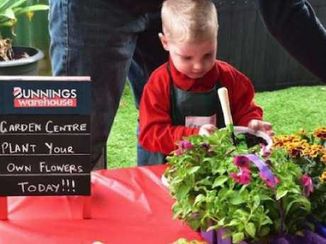 Carter Stingers enjoys the garden centre at  his Bunnings-themed birthday party. Picture: Kylie Stingers