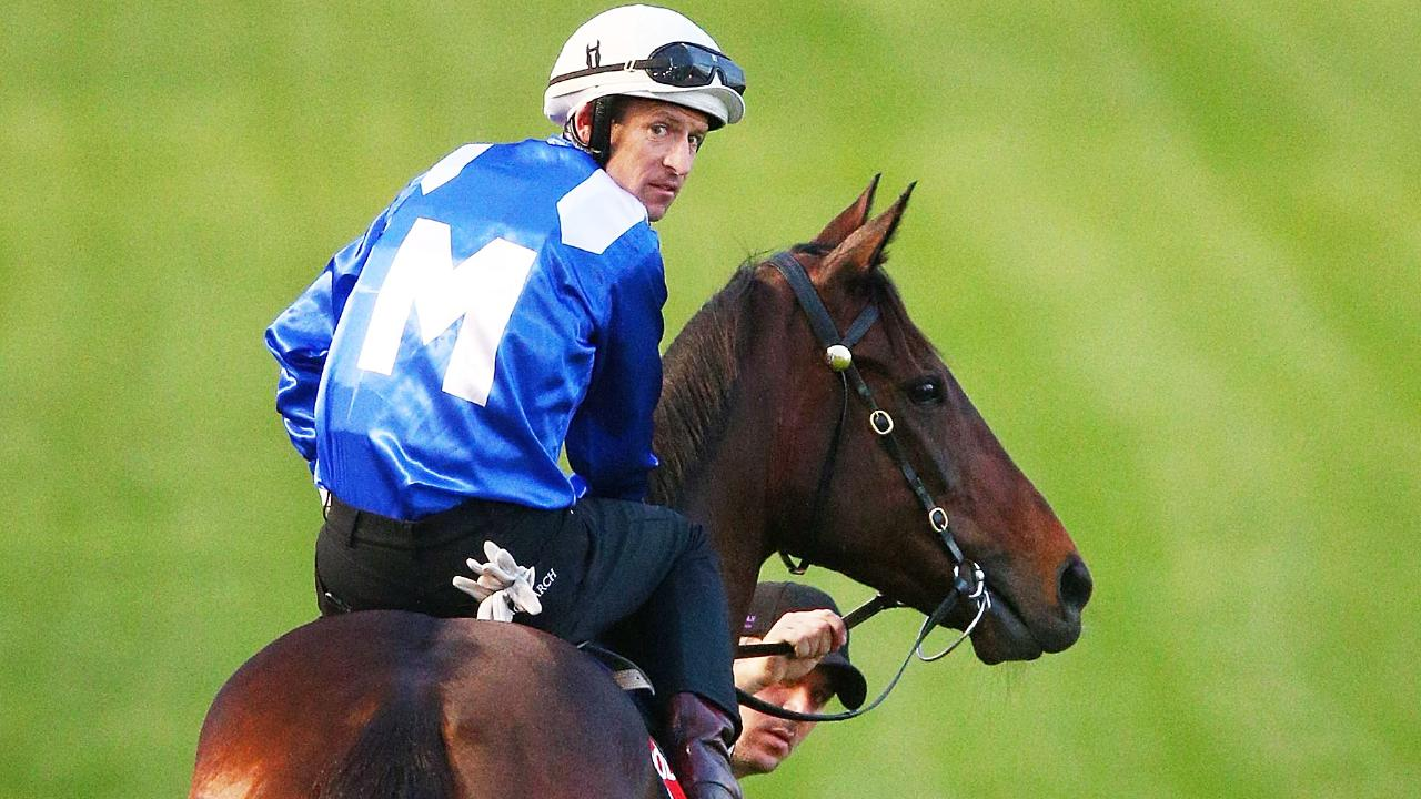 Hugh Bowman heads out on Winx on Tuesday for a gallop at Breakfast with the Best at Moonee Valley. Picture: Michael Dodge/Getty Images