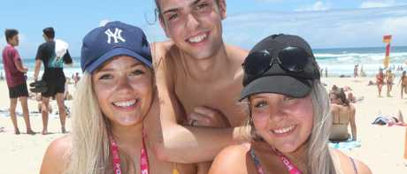 Schoolies from Southern States pictured stocking up on supplies and enjoying Surfers Paradise Beach. L-R Brittney Moorehouse, Declan Scott and Melissa Batsanes — plans are afoot to make the Schoolies beachfront festival one big fortnight with a paid ticket allowing major acts. Picture Mike Batterham
