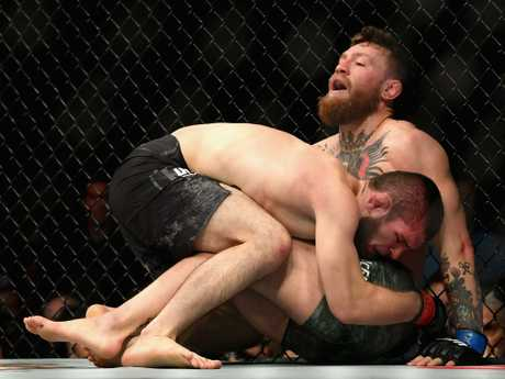 Khabib pinned McGregor early and wouldn't let go.