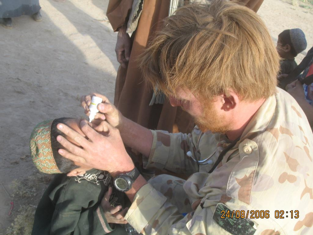 Voodoo Medic Dr Jeremy Holder would assist in the field hospital with trauma surgery and also administer eye drops for the local kids