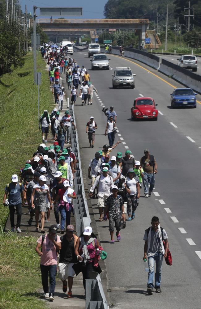 Hundreds have turned back, but more continue to join the caravan along the way. Picture: AP Photo/Moises Castillo