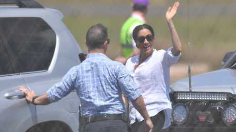 Meghan waves goodbye to Oz - but she'll be back soon. Picture: AAP