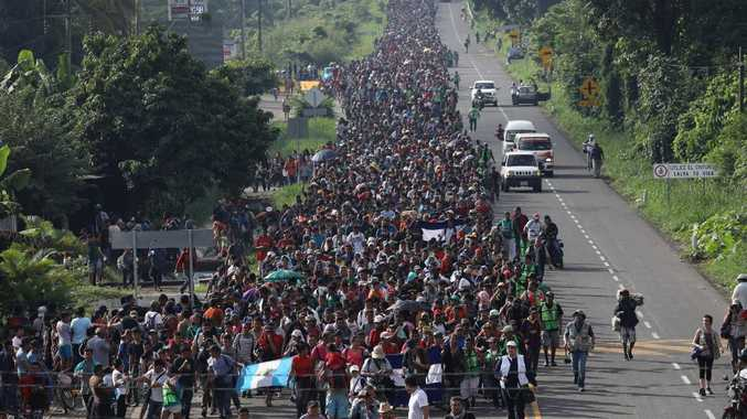 The migrant 'caravan', which has grown to around 5000 people, walks into the interior of Mexico after crossing the Guatemalan border on Sunday. Picture: John Moore/Getty Images