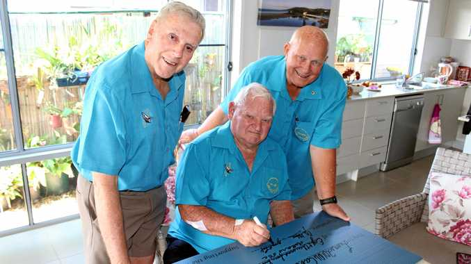 TEAM EFFORT: Fraser Lion's Club membership chairman Bruce Taylor, president George Fox and treasurer Colin Myvus sign a cheque for $8424.55 for drought-stricken farmers at Emerald, Longreach, Winton, and Springsure.