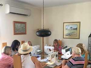 Zonta women hard at work making breast cushions