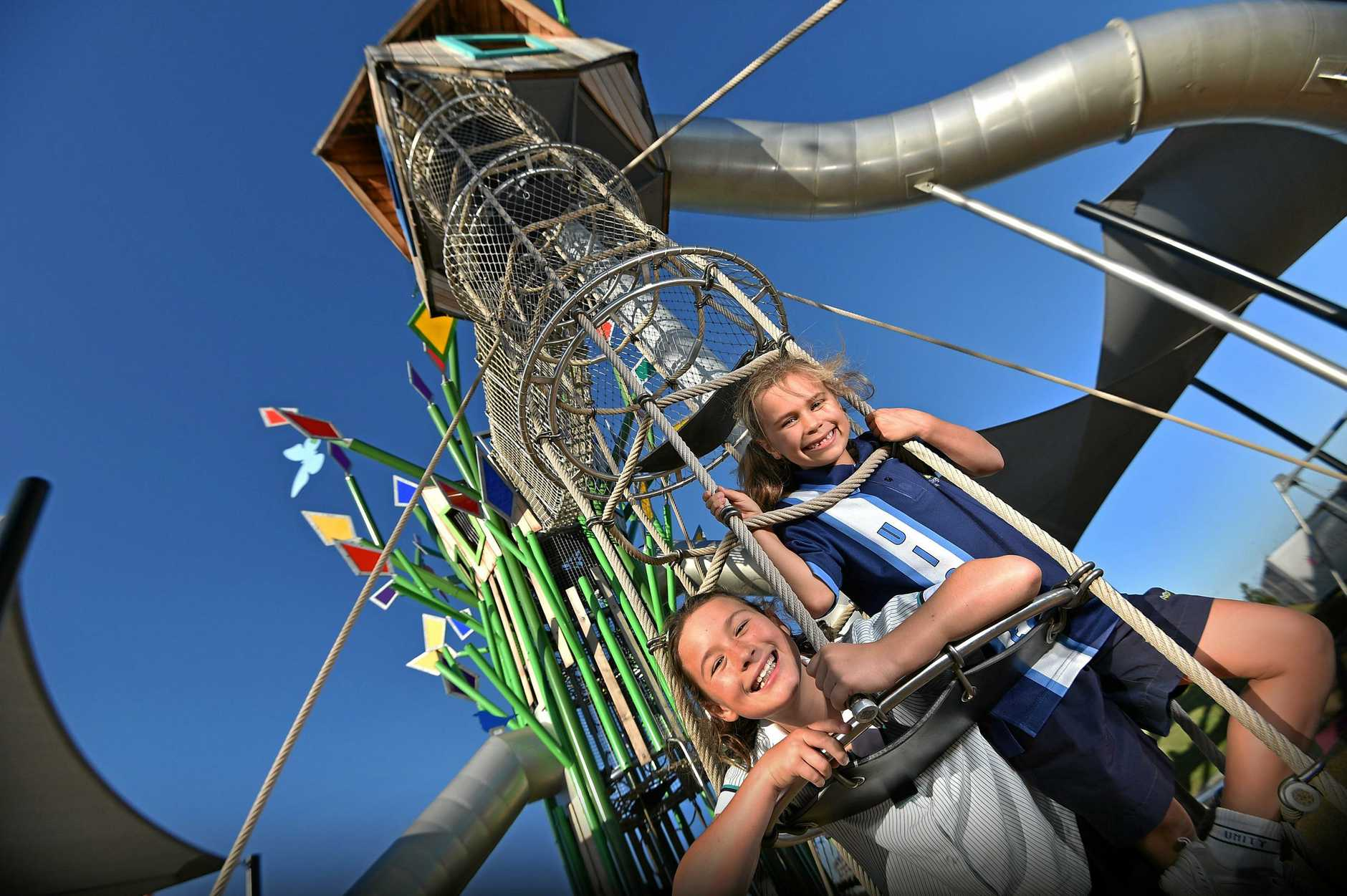 Out having fun on the space-age playground equipment at Aura are Millie and Summer Greig.