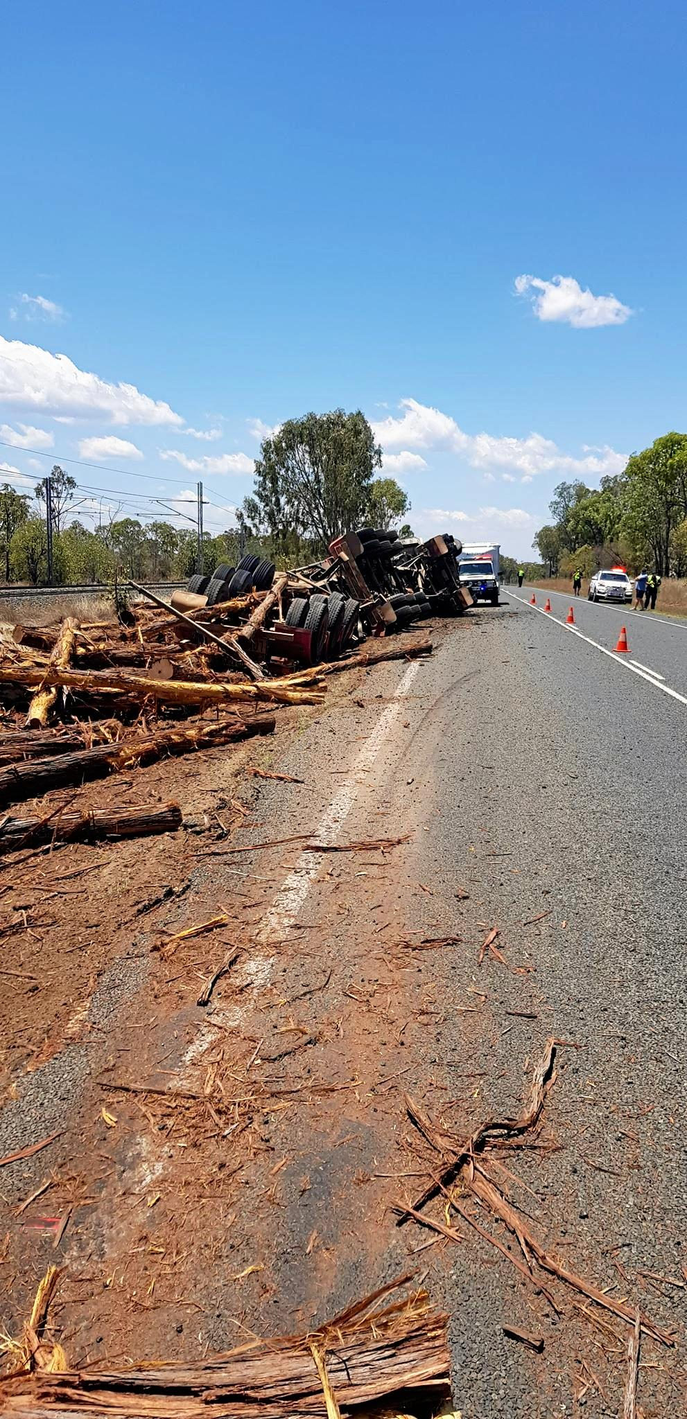 A truck carrying logs rolled on the Capricorn Highway on Wednesday morning.