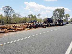 Logging truck roll-over blocks lane of busy CQ highway